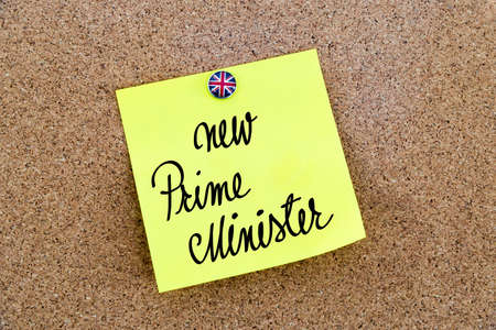 the prime minister: Yellow paper note pinned on cork board with Great Britain flag thumbtack, written text New Prime Minister, British Business concept