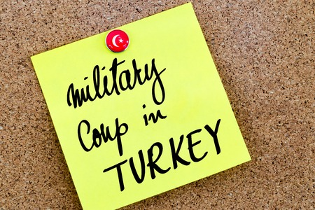 coup: Written text Military Coup in Turkey over yellow paper note pinned on cork board