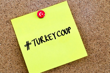 coup: Written text Hastag Turkey Coup over yellow paper note pinned on cork board