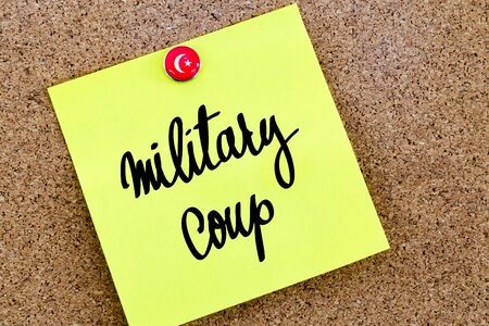 coup: Written text Military Coup over yellow paper note pinned on cork board