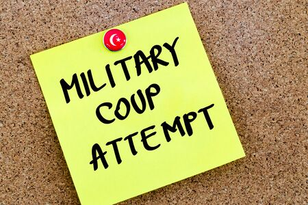 coup: Written text Military Coup Attempt over yellow paper note pinned on cork board Stock Photo
