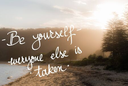 taken: Be Yourself, Everyone Else Is Taken message. Handwritten motivational text over sunset calm sunny beach background with vintage filter applied