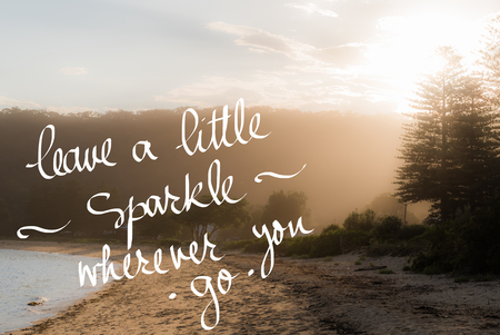 wherever: Leave A Little Sparkle wherever you Go message. Handwritten motivational text over sunset calm sunny beach background with vintage filter applied Stock Photo