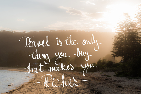 richer: Travel Is The Only Thing You Buy That Makes You Richer message. Handwritten motivational text over sunset calm sunny beach background with vintage filter applied