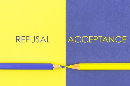 refusal: Refusal versus Acceptance contrast concept . Yellow and Violet coloured pencils and paper.
