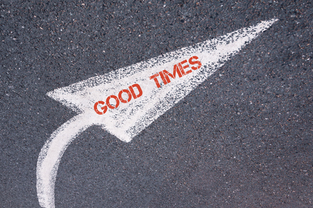 good times: Directional white painted arrow with words GOOD TIMES over road surface, concept image