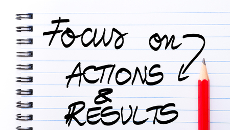 comunicación escrita: Focus On Actions and Results written on notebook page with red pencil on the right as Business Concept