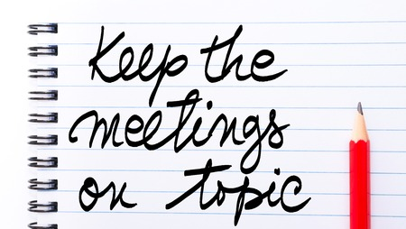 written communication: Keep The Meetings On Topic written on notebook page with red pencil on the right as Business Concept