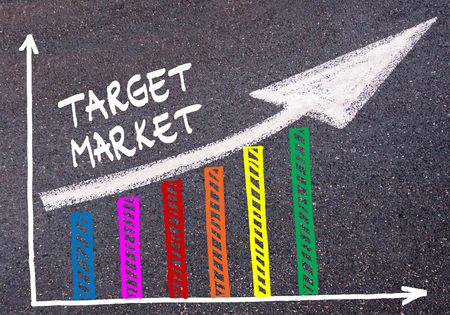 target market: Colorful graph drawn over tarmac and words TARGET MARKET with directional arrow, business design concept Stock Photo