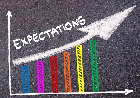 Colorful graph drawn over tarmac and word EXPECTATIONS with directional arrow, business design concept Stock Photo
