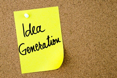idea generation: Idea Generation text written on yellow paper note pinned on cork board with white thumbtack. Business concept image with copy space available