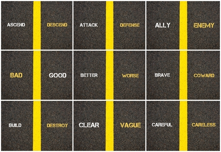 separating: Photo collage of antonym concepts written over tarmac, road marking yellow paint separating line between words