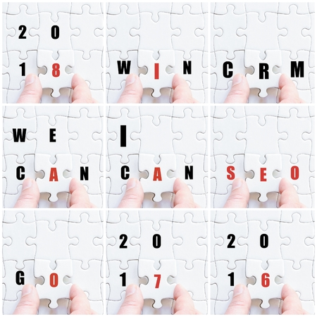 completing: Photo collage with hand of business man completing the puzzle with the last missing piece