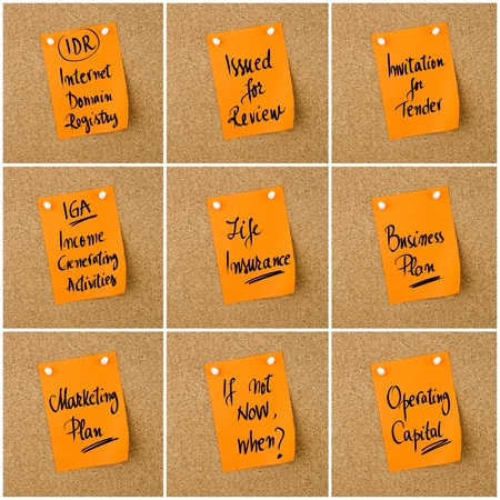 iga: Collage of Business Acronyms written on orange paper note pinned on cork board with white thumbtack, copy space available Stock Photo