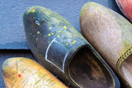 zaan: Zaanse Schans, Netherlands - January 10, 2017: Traditional handmade Dutch wooden shoes in Zaanse Schans village near Amsterdam, Netherlands. Klompen are whole feet clogs made of willow or poplar.