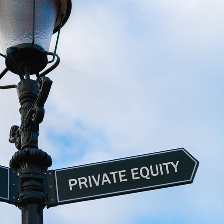 Street lighting pole with conceptual message PRIVATE EQUITY on directional arrow over blue cloudy background. Stock Photo