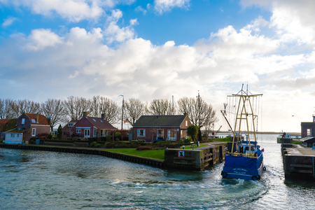Enkhuizen, Netherlands - January 12, 2017: Cityscape with ships and marina in the historic city of Enkhuizen, known for well-preserved historic houses and one of the largest marinas in Netherlands. Editorial