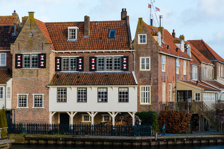 Enkhuizen, Netherlands - January 12, 2017: Cityscape in the historic city of Enkhuizen, known for well-preserved historic houses and one of the largest marinas in Netherlands.