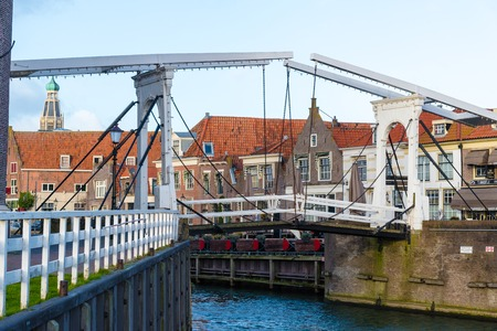 Enkhuizen, Netherlands - January 12, 2017: Cityscape with bridge and canal in the historic city of Enkhuizen, known for well-preserved historic houses and one of the largest marinas in Netherlands.