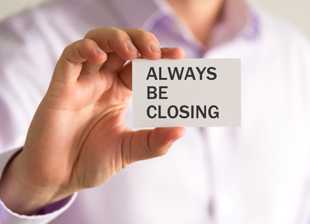 Closeup on businessman holding a card with ALWAYS BE CLOSING message, business concept image with soft focus background and vintage tone Stock Photo