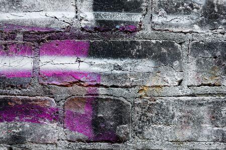 Brickwall vintage grunge background and graffiti spray
