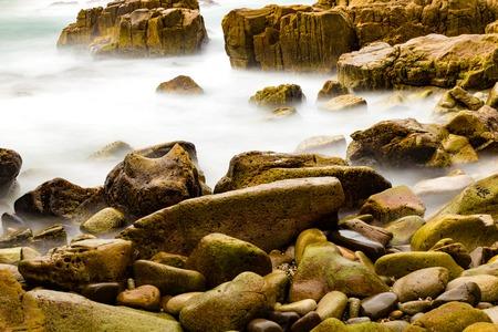 diamond stones: Colourful rocks and water at Diamond Head coast, Australia Stock Photo