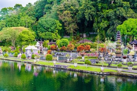 former: Bali, Indonesia - May 3, 2017 : Tirta Gangga, the former royal water palace is a maze of pools and fountains surrounded by a lush garden and stone carvings and statues near Karangasem, Bali, Indonesia