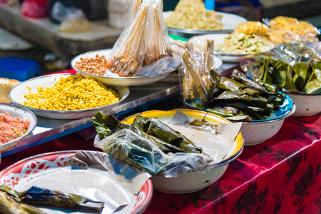 Food stalls at Gianyar Night Market, a top destination for hungry locals and tourists, offering a large variety of traditional balinese food in Gianyar province, Bali, Indonesia Editorial