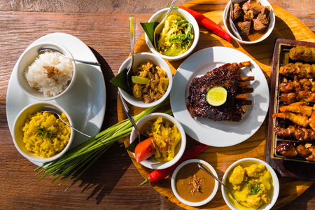 Traditional balinese sea food with satay and curry in Bali, Indonesia Imagens