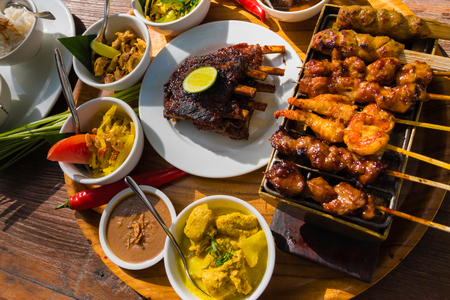 Traditional balinese sea food with satay and curry in Bali, Indonesia Standard-Bild