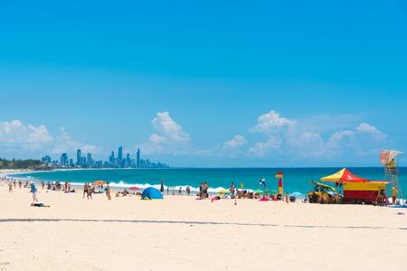 Currumbin, Queensland, Australia-December 23, 2017 : Coastal sand beach with Gold Coast skyline from Surfers Paradise on the horizon, a major tourist destination with subtropical climate.