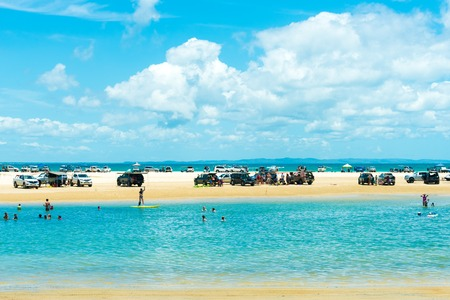 Rainbow Beach, QLD, Australia- December 30, 2017: 4wd vehicles at Rainbow Beach, a popular tourist destination and a gateway to Fraser Island, its name derives from the rainbow-coloured sand dunes.