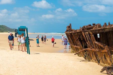 Fraser Island, QLD, Australia - December 31, 2017: People at the Maheno shipwreck on 75 mile beach, one of the most popular landmarks on Fraser Island, Fraser Coast, Queensland, Australia.