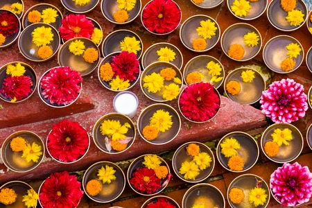Close-up on Buddhist flower offerings in bowls. In Buddhism symbolic offerings are made to generate contemplative gratitude and inspiration