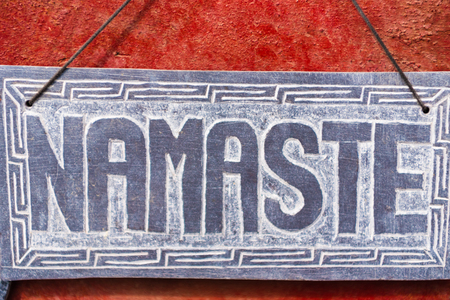 Kathmandu, Nepal - July 15, 2018 : Namaste sign as souvenir at Monkey temple Swayambhunath Stupa complex, a UNESCO heritage site and an important place of pilgrimage for Buddhists all over the world