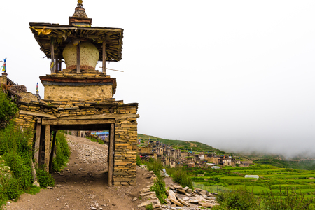 Nar village, Annapurna Conservation Area, Nepal - July 21, 2018 : Green terraced fields and traditional architecture in the ancient Tibetan Nar village, Annapurna Conservation Area, Nepal