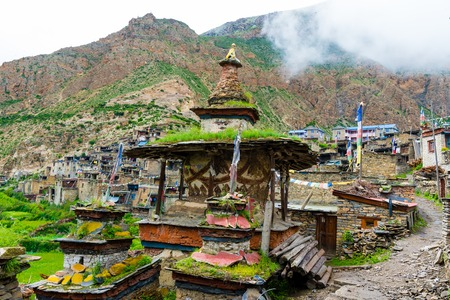 Nar village, Annapurna Conservation Area, Nepal - July 22, 2018 : Green terraced fields and traditional architecture in the ancient Tibetan Nar village, Annapurna Conservation Area, Nepal