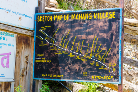Annapurna Conservation Area, Nepal - July 24, 2018 : Touristic information sign in Manang village, Annapurna Conservation Area, the largest protected area of Nepal