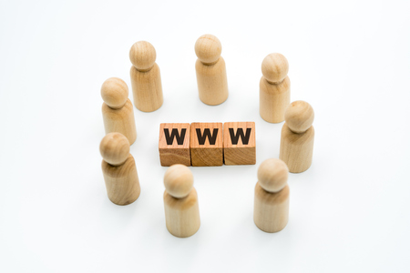 Wooden figures as business team in circle around acronym WWW World Wide Web, isolated on white background, minimalist concept Imagens