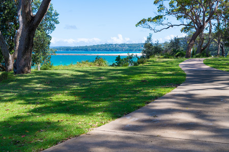 Huskisson, NSW, Australia-December 22, 2018: Water view from coastal walking path in the city of Huskisson, NSW, Australia, a small coastal town well known as gateway to Jervis Bay area 報道画像