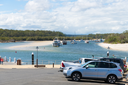 Huskisson, NSW, Australia-December 22, 2018: View over bay of water and boats in the city of Huskisson, NSW, Australia, a small coastal town well known as gateway to Jervis Bay area