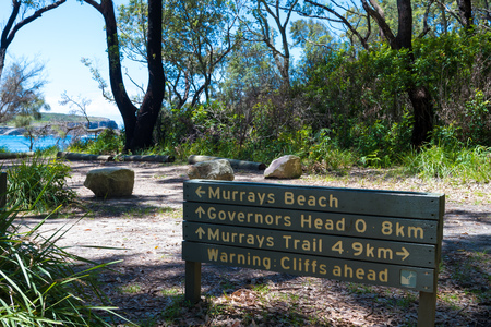 Cave Beach, NSW, Australia-December 23, 2018: Information guidance sign to the tranquil, white-sand Murrays Beach in Jervis Bay, Booderee National Park, NSW, Australia 報道画像