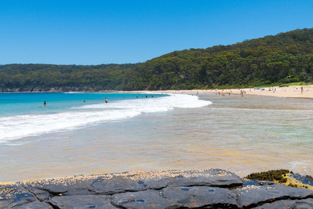Pebbly Beach, NSW, Australia-January 4, 2019: People enjoying the sunny weather at Pebbly Beach, a popular camping area with great surfing beach and bush walks within Murramarang National Park. 報道画像