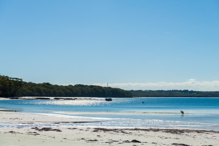 Hole In The Wall Beach, NSW, Australia-December 23, 2018: People enjoying the sunny weather at Hole In The Wall Beach in Jervis Bay, Booderee National Park, NSW, Australia.