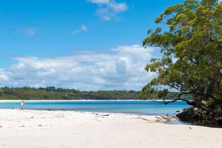 Galamban Green Patch Beach, NSW, Australia-December 24, 2018: People enjoying the sunny weather at Galamban Green Patch beach in Jervis Bay, a quiet getaway location to enjoy surf and sunshine.