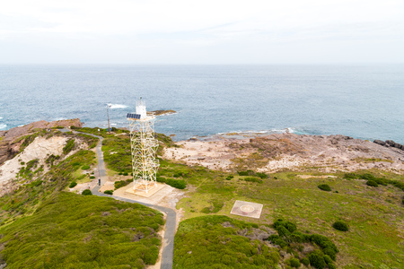 Green Cape lighthouse, NSW, Australia-December 31, 2018: View over remote Green Cape lighthouse, the southernmost lighthouse in New South Wales, located in Ben Boyd National Park, Australia. 報道画像