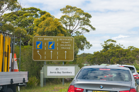Jervis Bay Territory, ACT, Australia-December 23, 2018: Cars waiting in queue for park passes at the entrance point in Jervis Bay National Park, one of Australias most popular seaside destinations