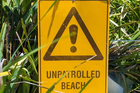 Unpatrolled beach warning sign in Australia