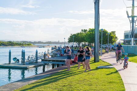 Forster, NSW, Australia-April 20, 2019: People enjoying the sunny weather on the waterside in the city of Forster, a coastal town in the Great Lakes region of New South Wales, Australia Editorial