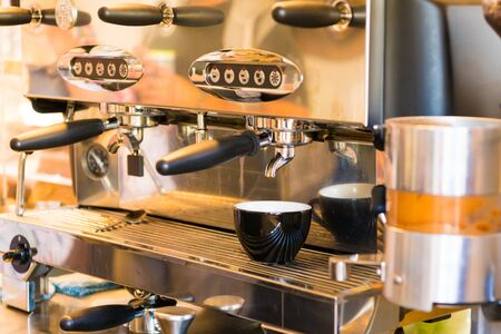 Close-up of espresso coffee machine. Professional coffee brewing 写真素材 - 132087398